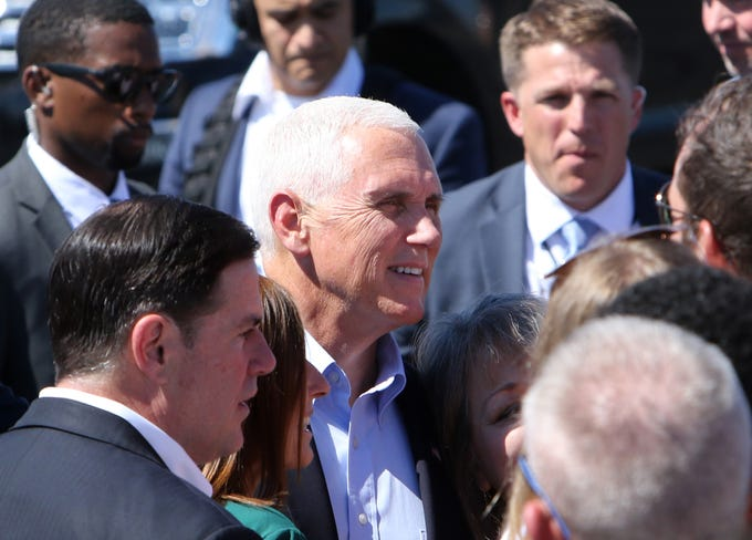 Vice President Mike Pence poses for a photograph at Tucson International Airport on Oct. 3, 2019. Arizona Gov. Doug Ducey and Sen. Martha McSally are to his left.