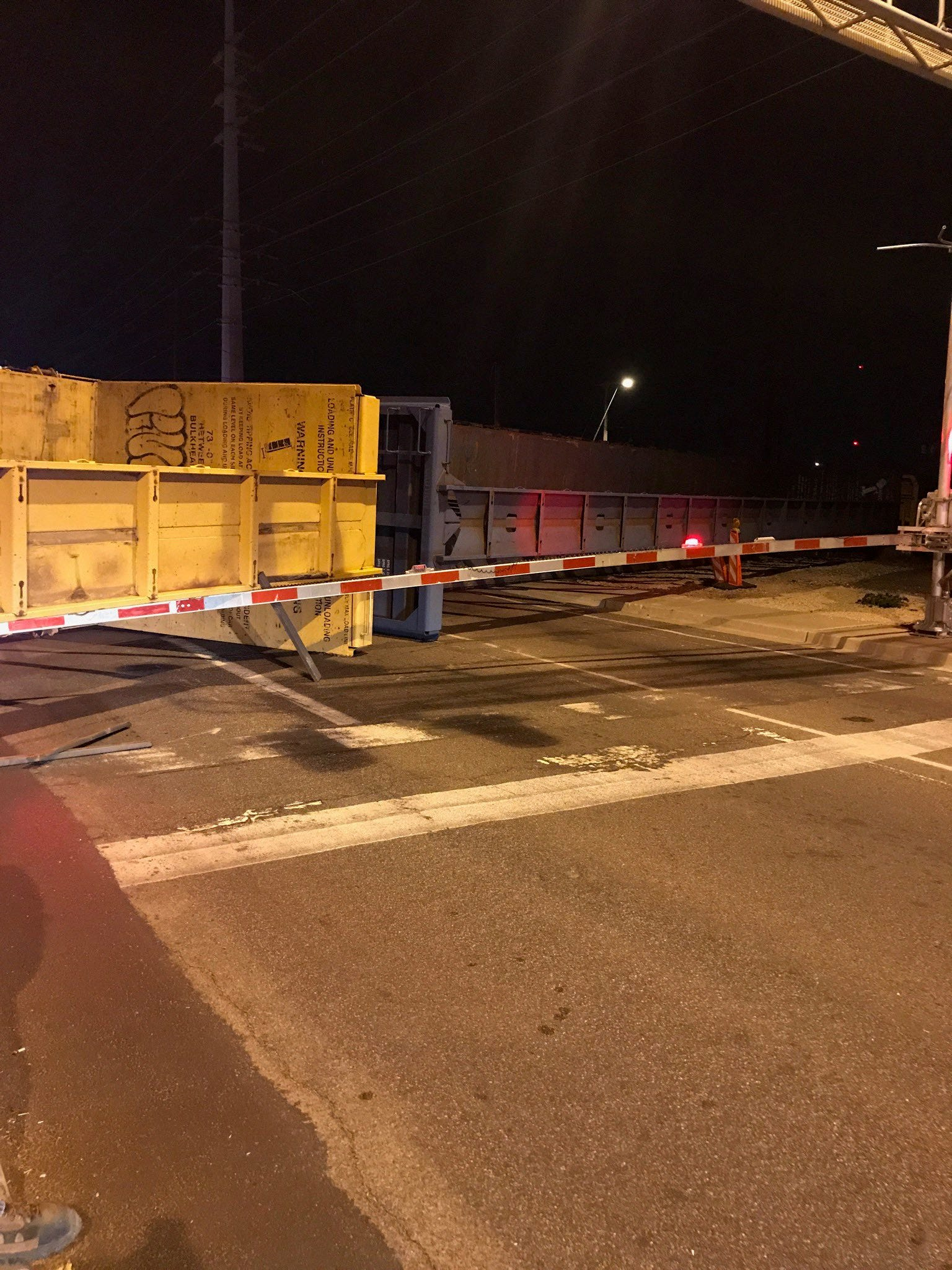 Overturned railroad car blocks traffic at Mesa intersection