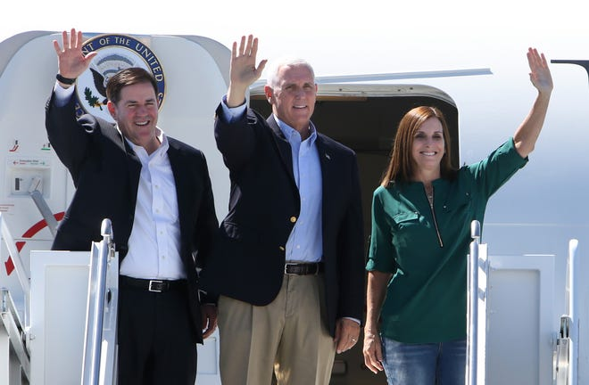 Vice President Mike Pence arrives at Tucson International Airport on Oct. 3, 2019, flanked by Arizona Gov. Doug Ducey and Sen. Martha McSally.