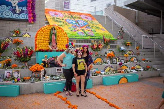 During the Mesa Art Center's Dia de Los Muertos festival, visitors can leave mementos for deceased love ones at the community altar.