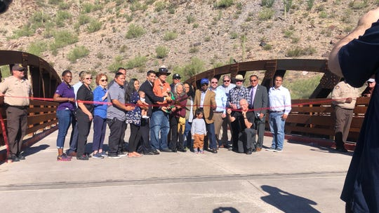 The Piestewa family and members of the Hopi Tribe participate in the ribbon-cutting ceremony opening up the new vehicle/pedestrian bridge Friday.