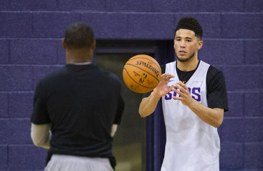 Guard Devin Booker is given the ball during a shooting drill at Phoenix Suns practice at the Rolle Activity Center at Northern Arizona University in Flagstaff, Wednesday, October 2, 2019.
