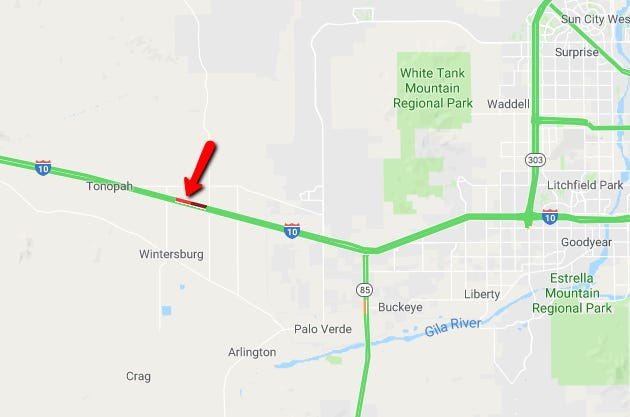 A semitruck rollover crash caused a closure of westbound Interstate 10 west of Phoenix, according to the Arizona Department of Transportation.