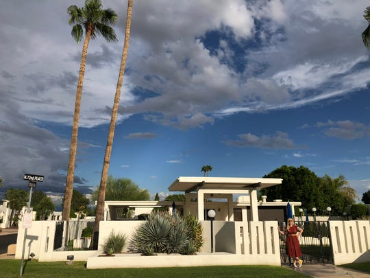 Jennifer Hibbard poses in front of a townhome in the Sands North community near Scottsdale Road and Indian Bend Road.