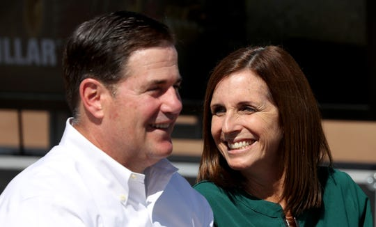 Governor Doug Ducey, left, and U.S. Senator Martha McSally talk during Vice-President Mike Pence's visit to the Caterpillar's Tinaja Hills Demonstrations and Learning Center, Green Valley, Ariz., Oct. 3, 2019.