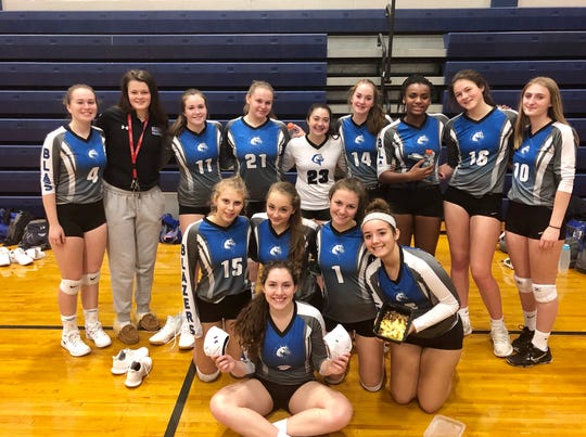 The Millbrook volleyball team poses for a photo after its victory over Spackenkill on Thursday.