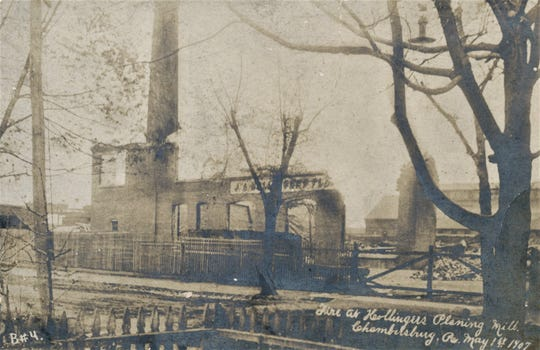 A view from Broad Street showing the destruction caused by the fire on May 1st, 1907. This building was torn down and another millworks operation was built at this location.