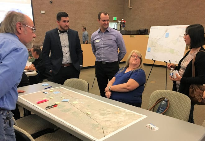 Fernley residents mark problem areas of the city's roads on a map.