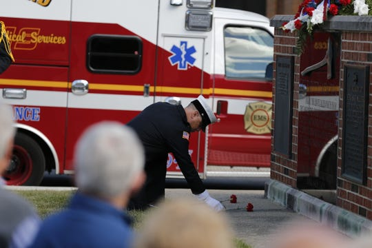 A flower is placed near the Firefighters Memorial to honor a Richmond Fire Department member who died in the line of duty.