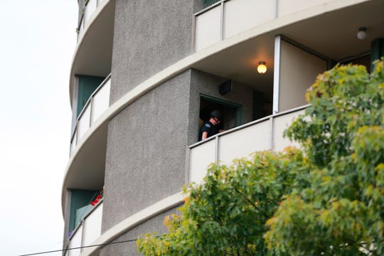 Police respond to a report of gunfire at Smith Tower Apartments in downtown Vancouver, Wash., Oct. 3, 2019. Authorities say a man opened fire Thursday in the lobby of the apartment building for seniors, striking several people.