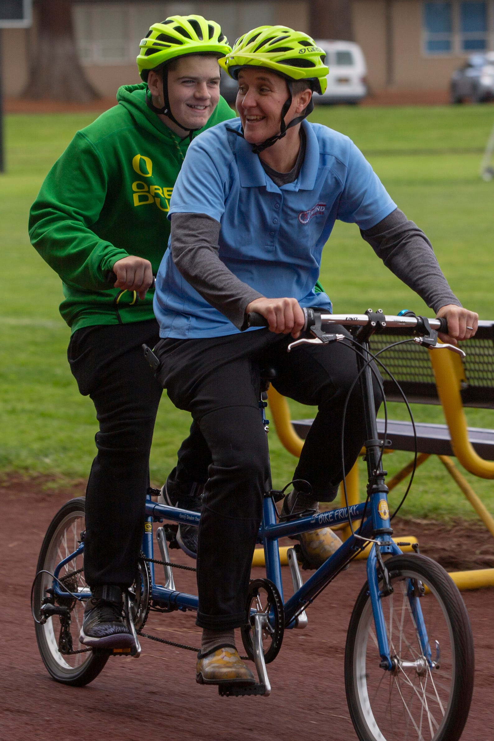 "Tandem biking instructor Megan Ahleman and tenth-grader Jaden Kemper go for a spin at the Oregon School for the Deaf in Salem, Oct. 4, 2019. NWABA, the Northwest Association for Blind Athletes, hosted a ""Paralympic experience"" for students with visual impairments in the state. After the Oregon School for the Blind closed in 2009, many visually impaired students and their families lost access to state-funded resources, like sports programs. The BVIS (Blind Visually Impaired Student) Fund gives programs like NWABA funds to enhance the lives of low vision/blind children across the state."
