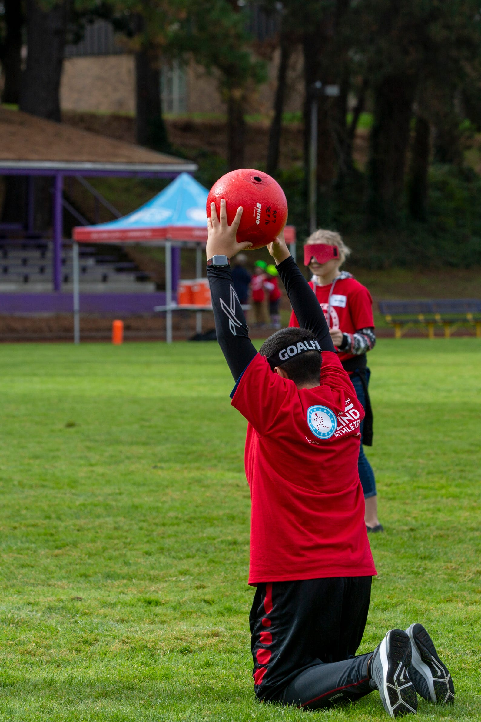 "Elwin Rivera, a 7th grader, catches the ball during beep kickball at the Oregon School for the Deaf in Salem, Oct. 4, 2019. NWABA, the Northwest Association for Blind Athletes, hosted a ""Paralympic experience"" for students with visual impairments in the state. After the Oregon School for the Blind closed in 2009, many visually impaired students and their families lost access to state-funded resources, like sports programs. The BVIS (Blind Visually Impaired Student) Fund gives programs like NWABA funds to enhance the lives of low vision/blind children across the state."