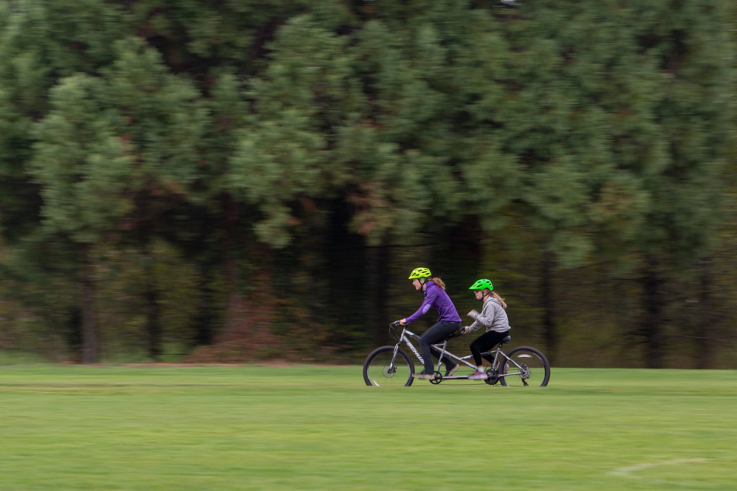 "Tandem biking instructor JoJo Smyth and eighth-grader Adara Hale cycle together at the Oregon School for the Deaf in Salem, Oct. 4, 2019. NWABA, the Northwest Association for Blind Athletes, hosted a ""Paralympic experience"" for students with visual impairments in the state. After the Oregon School for the Blind closed in 2009, many visually impaired students and their families lost access to state-funded resources, like sports programs. The BVIS (Blind Visually Impaired Student) Fund gives programs like NWABA funds to enhance the lives of low vision/blind children across the state."