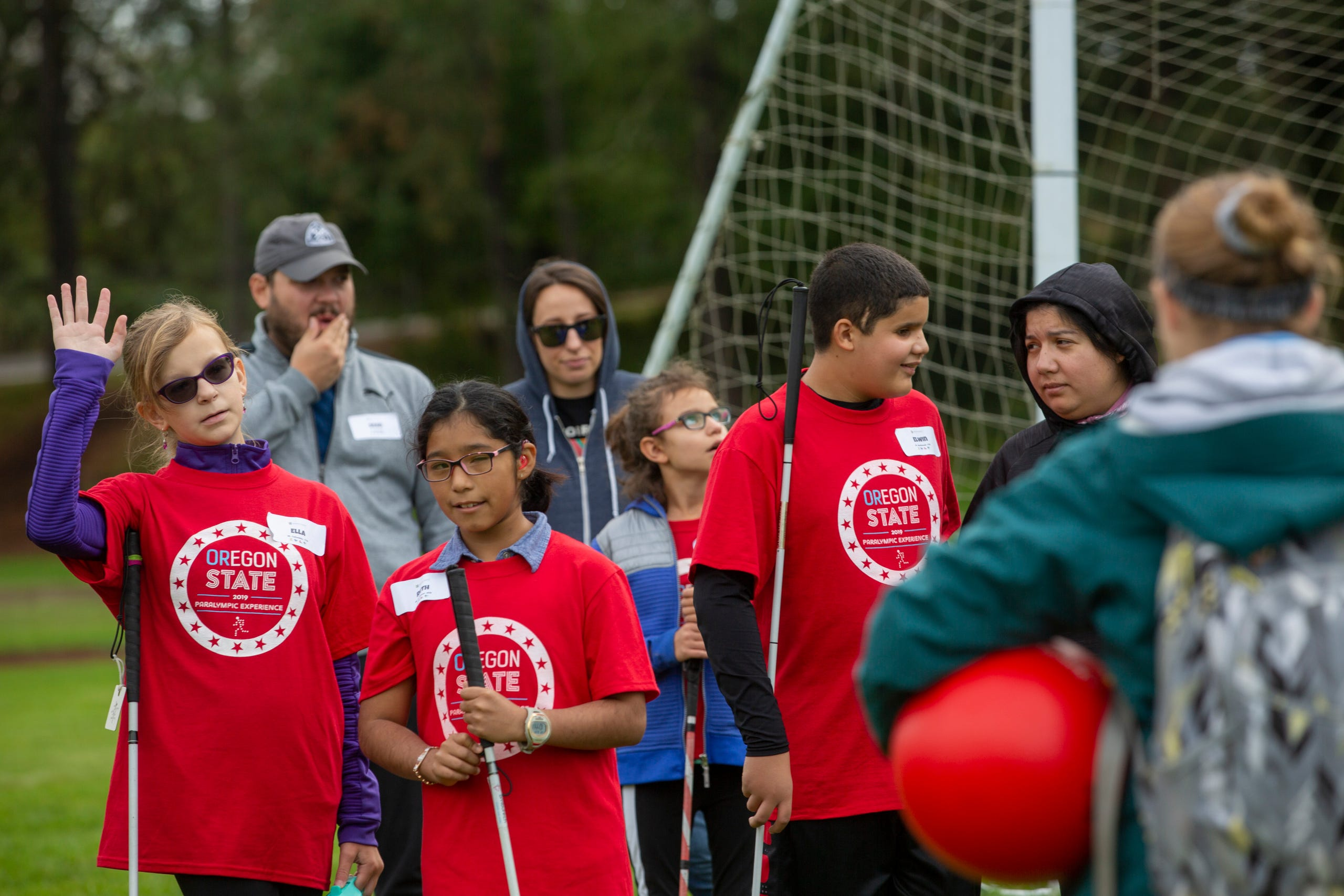 "Ella Shrout, a 7th grader, raises her hand to answer a question about beep kickball at the Oregon School for the Deaf in Salem, Oct. 4, 2019. NWABA, the Northwest Association for Blind Athletes, hosted a ""Paralympic experience"" for students with visual impairments in the state. After the Oregon School for the Blind closed in 2009, many visually impaired students and their families lost access to state-funded resources, like sports programs. The BVIS (Blind Visually Impaired Student) Fund gives programs like NWABA funds to enhance the lives of low vision/blind children across the state."