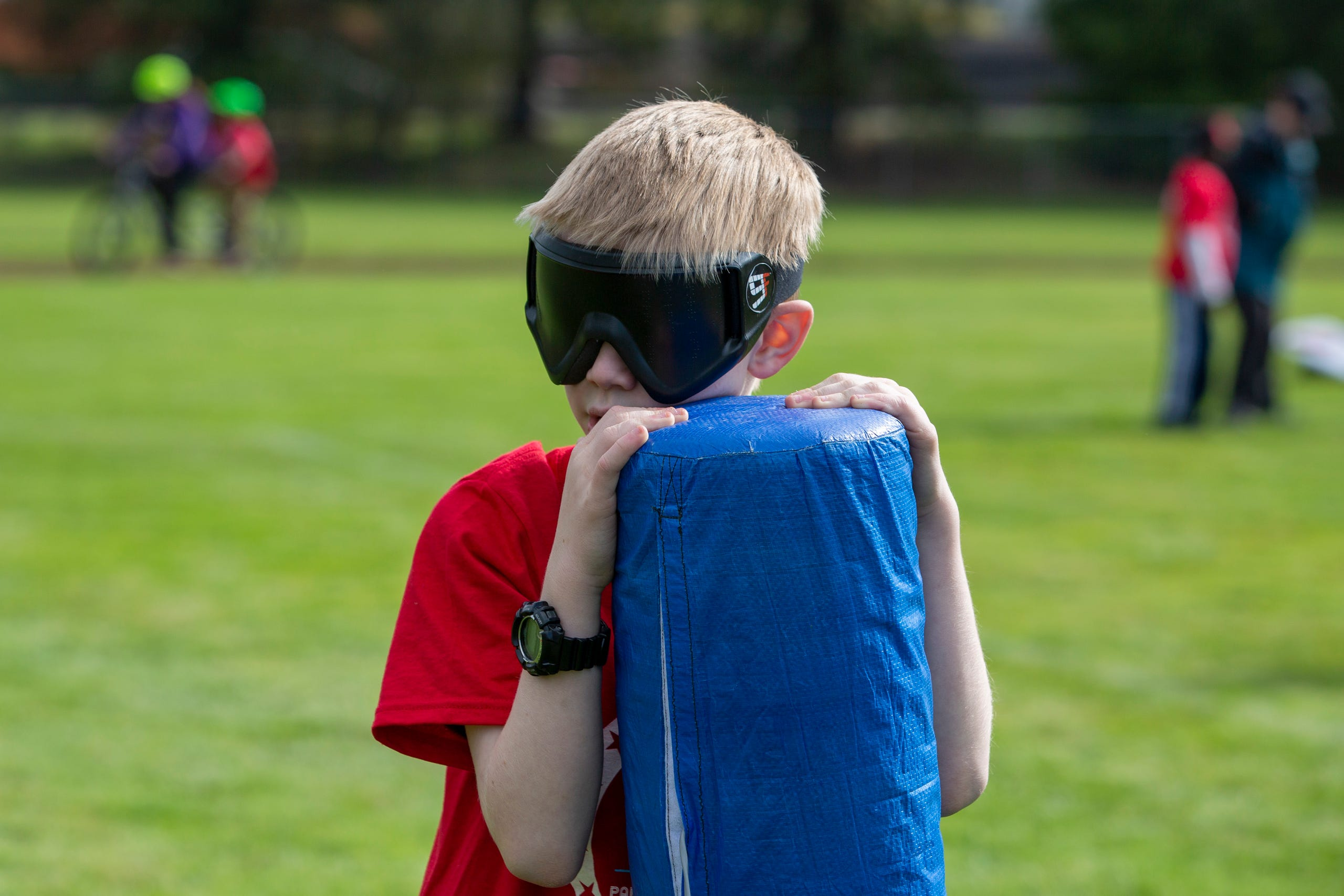 "Peter Gault, a 6th grader, holds onto the base during beep kickball at the Oregon School for the Deaf in Salem, Oct. 4, 2019. NWABA, the Northwest Association for Blind Athletes, hosted a ""Paralympic experience"" for students with visual impairments in the state. After the Oregon School for the Blind closed in 2009, many visually impaired students and their families lost access to state-funded resources, like sports programs. The BVIS (Blind Visually Impaired Student) Fund gives programs like NWABA funds to enhance the lives of low vision/blind children across the state."