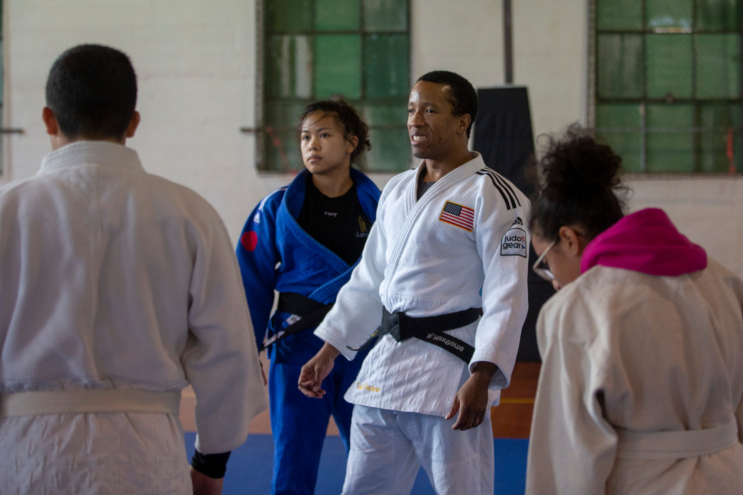 "Ron Hawthorne, a Judo Paralympian and Liana Mutia, a Judo World Champion, teach students judo at the Oregon School for the Deaf in Salem, Oct. 4, 2019. NWABA, the Northwest Association for Blind Athletes, hosted a ""Paralympic experience"" for students with visual impairments in the state. After the Oregon School for the Blind closed in 2009, many visually impaired students and their families lost access to state-funded resources, like sports programs. The BVIS (Blind Visually Impaired Student) Fund gives programs like NWABA funds to enhance the lives of low vision/blind children across the state."