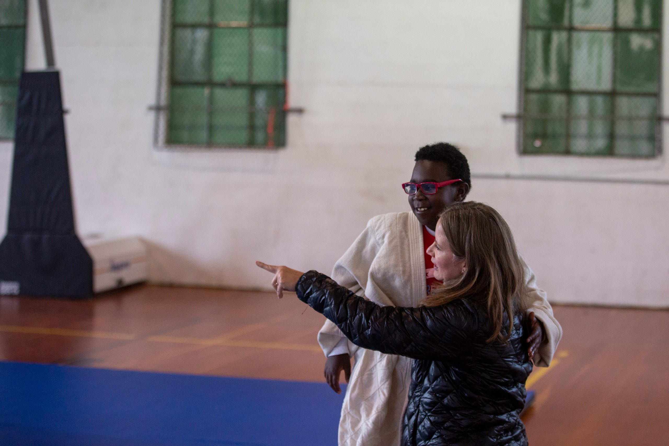 "Pasha Knolporr, a 5th grader, and Kristin Gaultat prepare for judo practice at the Oregon School for the Deaf in Salem, Oct. 4, 2019. NWABA, the Northwest Association for Blind Athletes, hosted a ""Paralympic experience"" for students with visual impairments in the state. After the Oregon School for the Blind closed in 2009, many visually impaired students and their families lost access to state-funded resources, like sports programs. The BVIS (Blind Visually Impaired Student) Fund gives programs like NWABA funds to enhance the lives of low vision/blind children across the state."