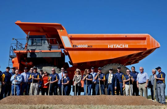 Car3 Goodyear employees and invited guests take part in a ground-breaking ceremony in front of a large earth mover at the proving grounds site in San Angelo on Wednesday.