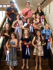 San Angelo Suzuki Strings Studio Student State Competitors: Top row left to right: Lucas Moralez, Jonathan Deanda, Alyssa Labra. Third row left to right: Arabella Dunlap, Adelyn Sohn, Kaylee Duryea. Second row left to right: Ella Elkins, Finlay Patterson. Bottom row left to right: Carol Morgado, Avery James, Kaitlyn Perlas. Not pictured: Kayly Chapoy, Andres Garcia, Olivia Rowe, Franchesca Untalan, Li Devereaux, Ava James, Emma Cotton, Evan Busenlehner, Elle Peterson and Emma Peterson.