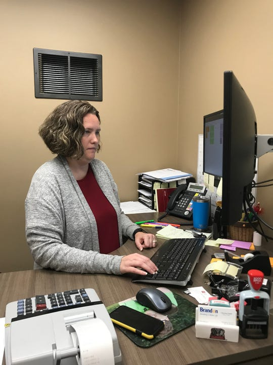 Brandon Finance Officer, Christina Smith, works on the new paperless billing online service at City Hall on Thursday, Oct. 3.