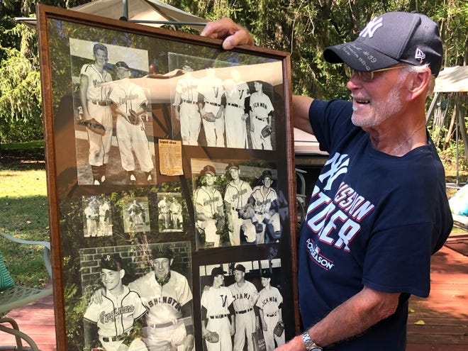 Jimmy Patterson shows off some framed photographs of his days as a bat boy with the Richmond Virginians.