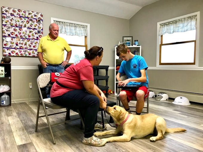 Richard Landes stands back while Samuel Bohlmann and his dog Stella train with Stacey Payne, co-founder of God's Canine Angels in Stuarts Draft, Virginia, on Tuesday, Sept. 17, 2019. Landes gave his dog Stella to Samuel when he learned that Samuel's service dog Chip had passed away.