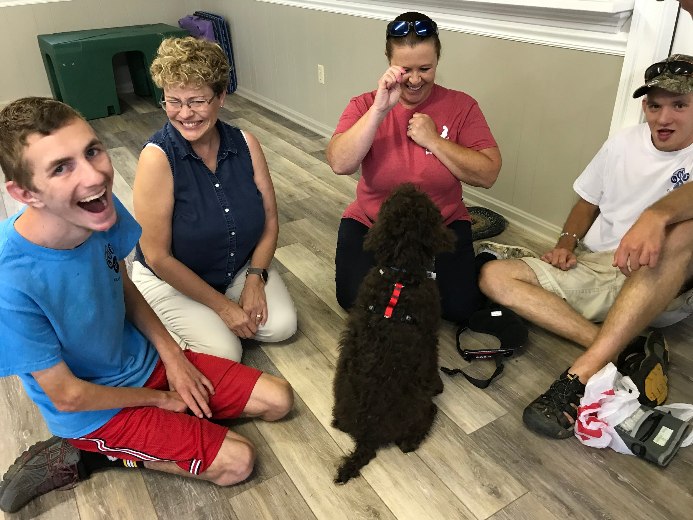 Samuel Bohlmann, Sue Bohlmann, Stacey Payne and Mcgregor Knemoller with his service dog Mace at God's Cane Angels on Tuesday, Sept. 17, 2019 in Stuarts Draft, Virginia.