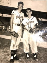 Jimmy Patterson, right, became a bat boy for the Richmond Virginians as a 12-year-old.