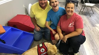 Nonprofit brings people with disabilities and service dogs together.