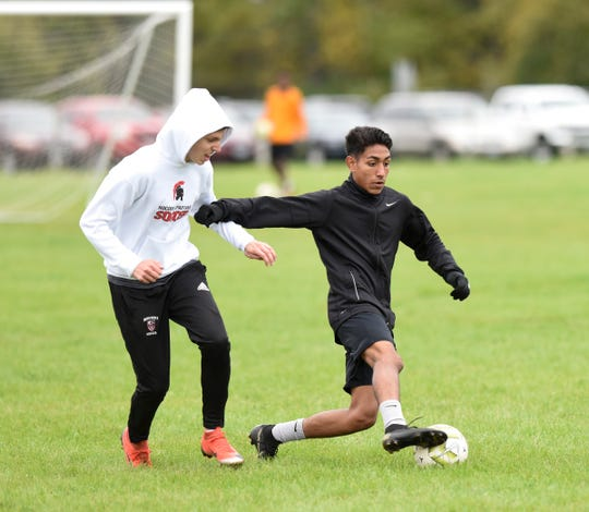 ROCORI senior Christian Rodriguez evades a defender at practice Thursday, Oct. 3, 2019, at ROCORI High School. Rodriguez leads the state with 40 goals in 16 games.