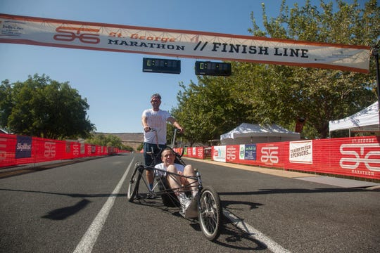 Brian Connolly rides in his marathon trike for the first time while his brother, Dan Connolly, pushes Friday, Oct. 4, 2019.