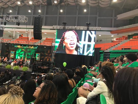 A singer with the FAMU Concert Choir Ensemble is featured on the large screen while singing at Friday's Homecoming Convocation. Oct. 4, 2019