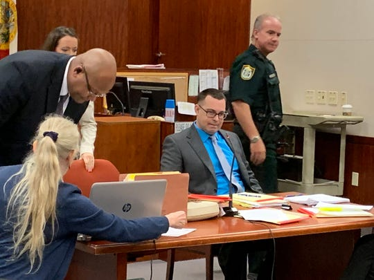Murder suspect Michael Jones, seated, assists his court-appointed lawyers Oct. 4, 2019 as they vet potential jurors for his first-degree murder trial at the Indian River County Courthouse in the 2014 homicide of Diana Duve.