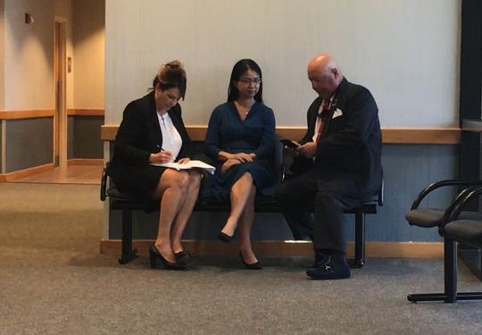 Ruimei Li (center), attorney Heidi Perlet (left)