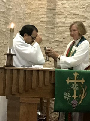 The Rev. Karen Leedahl gives communion to Bishop Pedro Suarez, leader of the Florida Bahamas Synod of the Evangelical Lutheran Church of America. He led the worship service at Christ the King Lutheran Church in Sebastian on Sept. 22, 2019. Leedahl retired Sept. 30.