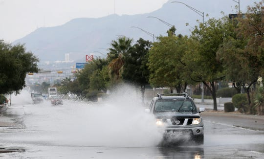 Motorists navigate a flooded Dyer Street on Friday morning, Oct. 4, 2019, in Northeast El Paso.