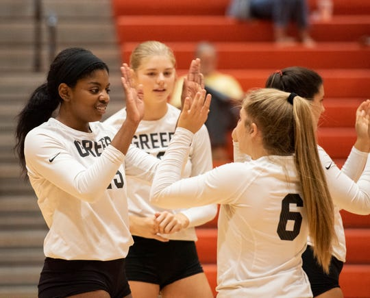 Rothani Allen, left, high-fives her teammates on the Greer High School volleyball team during recent a game against Southside High School.