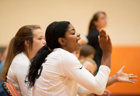 Rothani Allen encourages her teammates on the Greer High School volleyball team during recent a game against Southside High School.