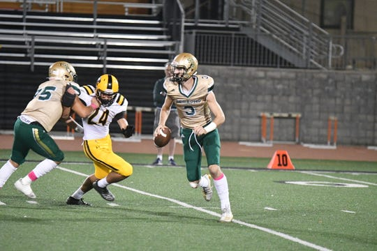 Quarterback Gavin Beerup scrambles in the pocket during the Seraphs' victory over Newbury Park in a Marmonte League opener Thursday night at Ventura College.