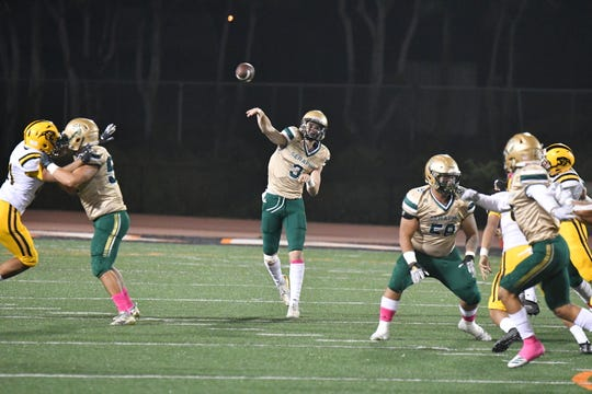 Senior quarterback Gavin Beerup fires a pass during the Seraphs' win over Newbury Park in a Marmonte League opener Thursday night at Ventura College.