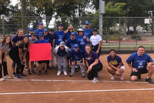 Cal Lutheran softball players, including senior slugger Kendall Marinesi (middle), held a clinic for Ventura County Special Olympians last week.
