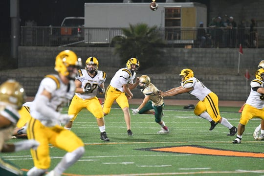 Newbury Park quarterback Ben Gulbranson delivers the ball during Thursday night's game against St. Bonaventure at Ventura College.