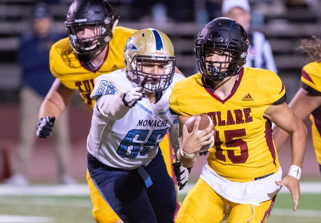 Tulare Union quarterback Jorge Gonzalez runs against Monache in an East Yosemite League football game on Thursday, October 3, 2019.