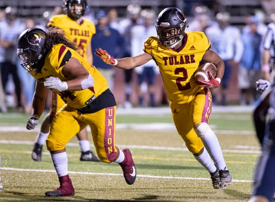 Tulare Union's John White runs against Monache in an East Yosemite League football game on Thursday, October 3, 2019.