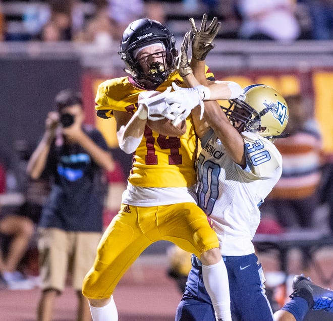 Tulare Union's Jordan Guerrero pulls down a pass under pressure from Monache's Jacob Vasquez in an East Yosemite League football game on Thursday, October 3, 2019. Guerrero scored on the play to put the Tribe up 13-3.