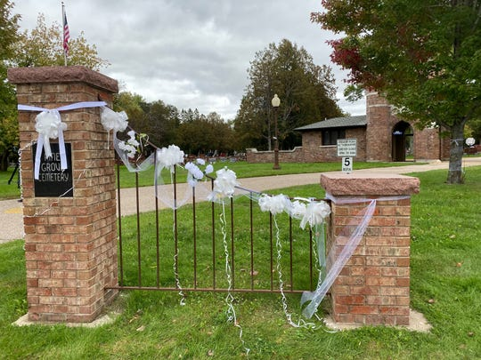 Ribbons hang on the gates at Pine Grove Cemetery on Friday, Oct. 4, 2019.