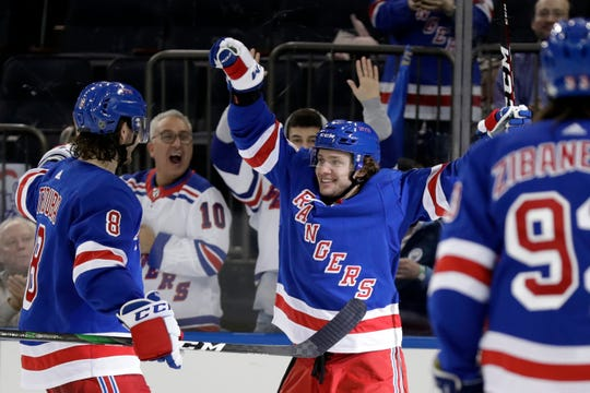 Oct 3, 2019; New York, NY, USA; New York Rangers left wing Artemi Panarin (10) celebrates scoring a goal with teammates during the second period against the Winnipeg Jets at Madison Square Garden.