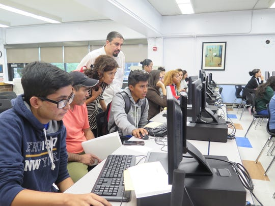 Yonkers students work on their FAFSA applications at Yonkers Partners in Education's annual FAFSA Night.