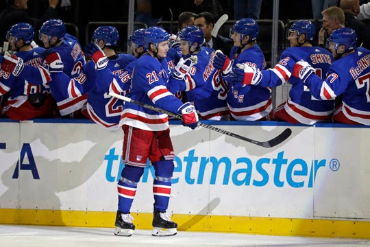 Oct 3, 2019; New York, NY, USA; New York Rangers center Brett Howden (21) celebrates scoring a goal during the third period against the Winnipeg Jets at Madison Square Garden.
