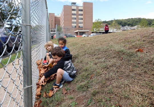 Children from a nearby daycare center collect leaves at MacCalman Field in Nyack Oct. 4, 2019. Neighbors of the park, which is used by several community groups, are trying to save it from being turned into a parking lot by Montefiore Nyack Hospital.